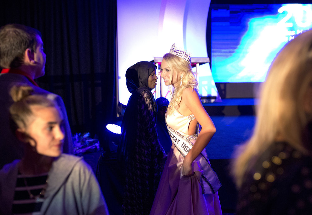"Ahmed and Miss Maine Teen USA winner Erin McPherson pass each other in the crowd after the end of the pageant. Ahmed didn't place in the pageant, but she said competing was a positive, ""life-changing experience"" for her."