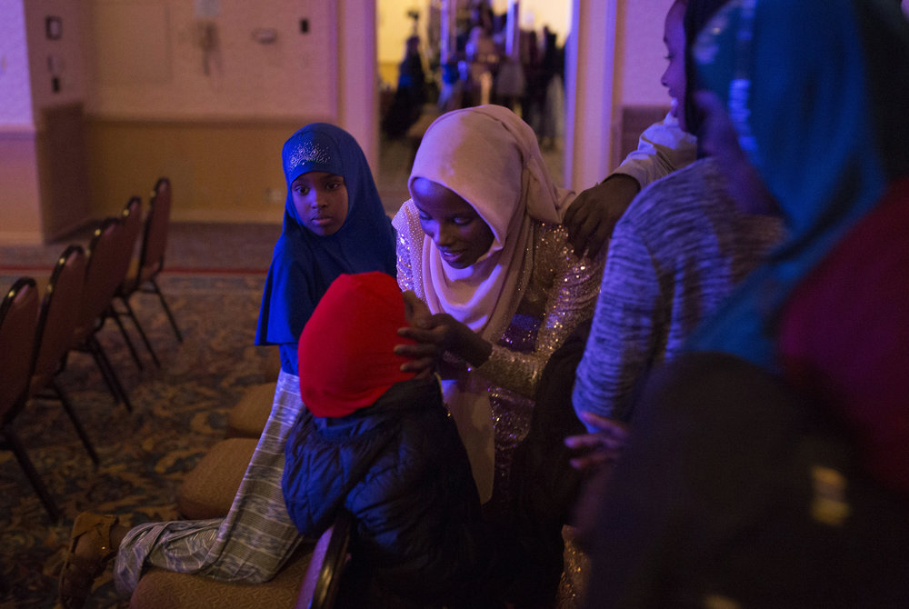 Hamdia Ahmed leans down to give her niece Zaytuun, 5, a kiss as her family surrounds her to congratulate her at the end of the two-day Miss Maine USA pageant.   Ahmed said that, most of all, she wanted other young Muslim girls, like her nieces, to know it was possible for them too.