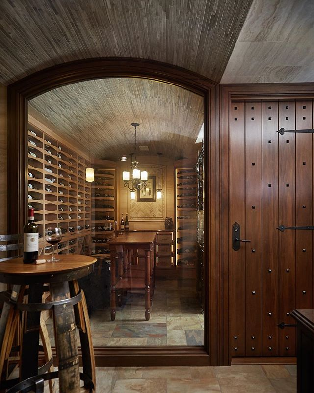The views into this custom  @revelcellars wine cellar are simply breathtaking! The entry system, window surround, and wine storage cabinetry were all handcrafted in our facility in Holland, MI. If you're serious about wine, this is the storage solution for you! #winecellars #wine #revelwinecellars #customcabinetry #handcrafted #madeinmichigan #puremichigan #hollandmi #entrydoor #views #winetasting #bar #tastingtable #tastingroom #winewheel PC: @ashleyavilaphotography