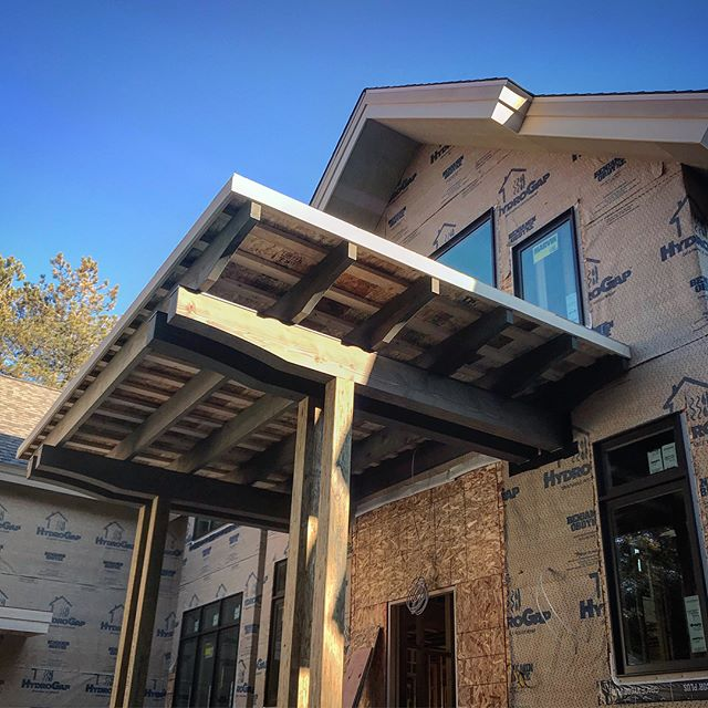 These #reclaimedwood Doug fir timbers are taking on new life at the @mikeschaapbuilders parade of home entry for this summer! Follow us for more progress pictures of the architectural and millwork details of this stunning house! #woodworking #benchmarkwoodstudio #brackets #beams #columns #wood #madeinmichigan #smallbusiness #customhomes #architecture #details #exterior