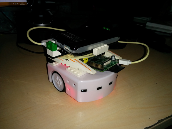 The Thymio robot with a Raspberry Pi and a battery allowing it to work without being tethered to a computer.