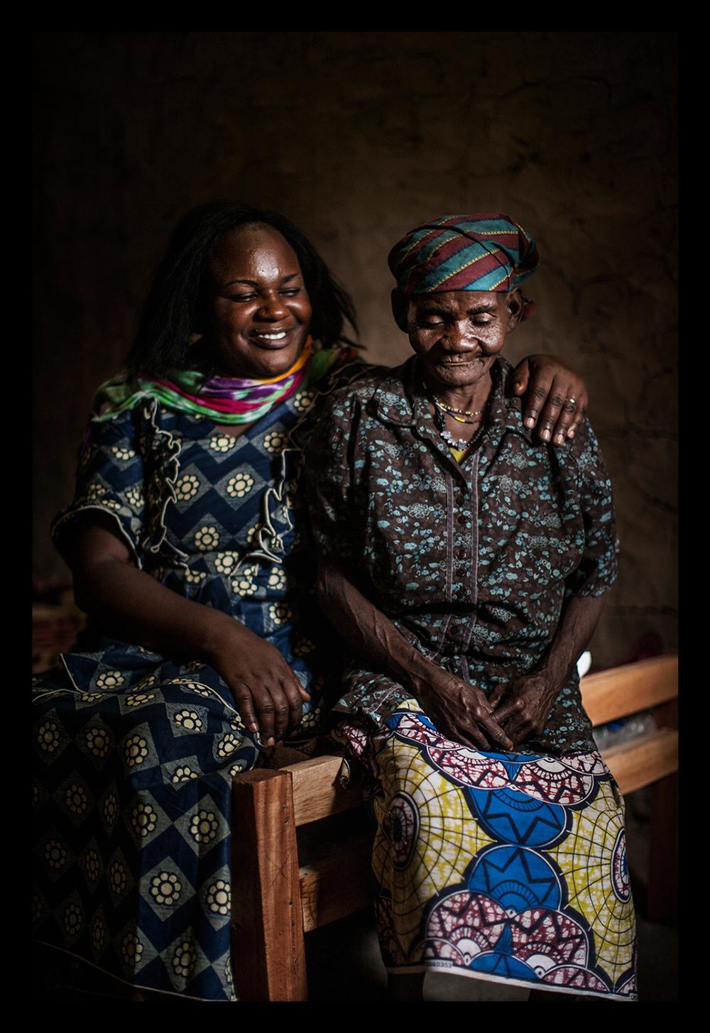 Kahindo Siherya Alphonsine poses with a Pygmy woman