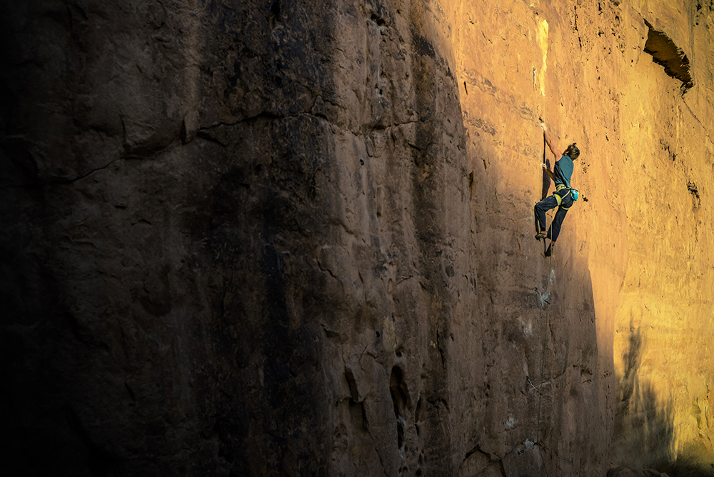 Jon Crawley rock climbing in the Ditch, Arizona.