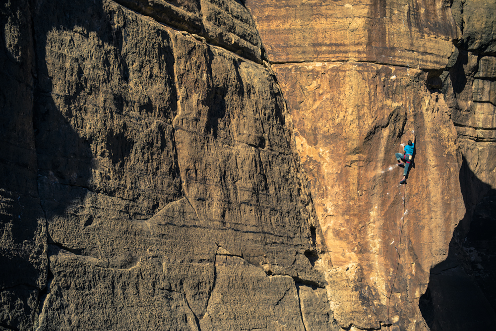 Mike Vaughn rock climbing in the Ditch, Arizona.