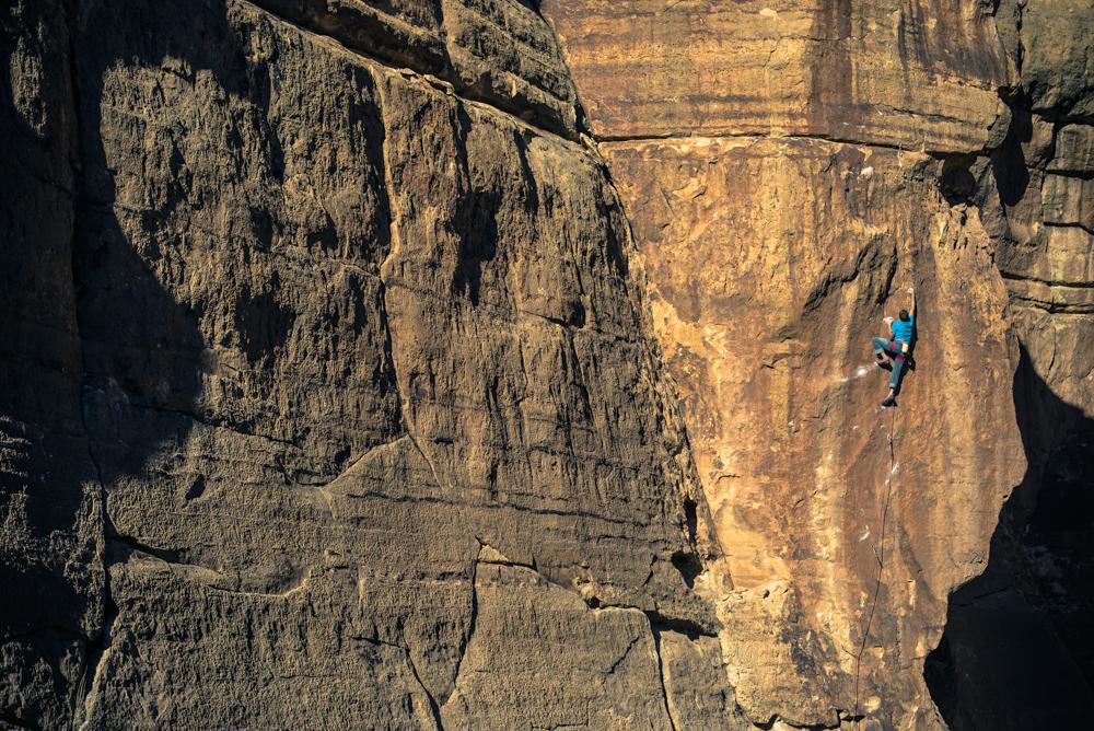 Mike Vaughn rock climbing in the Ditch, Arizona.