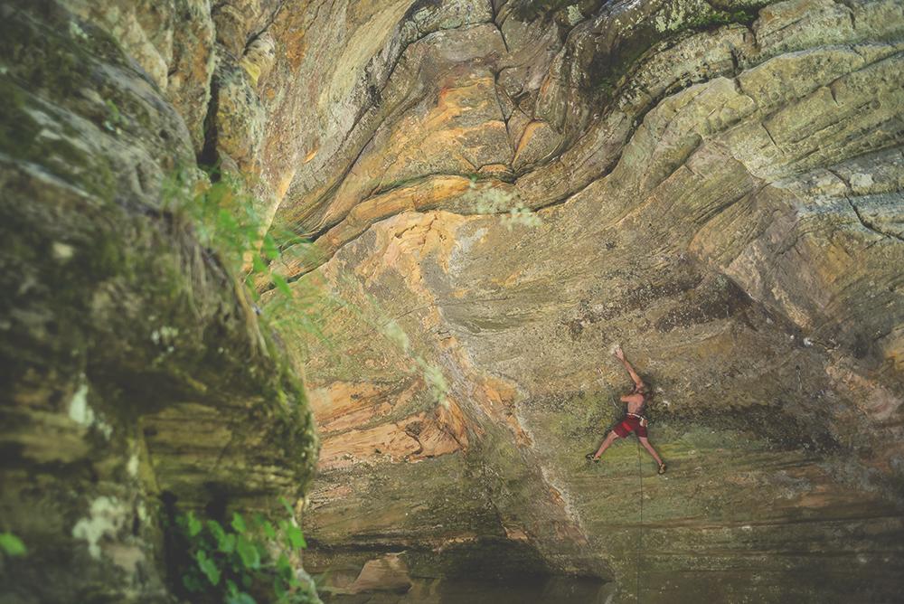 Zak rock climbing in James Canyon