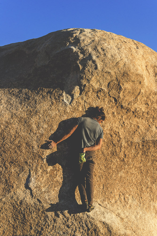 Rock climber at the Manx Boulders, Joshua Tree, California.