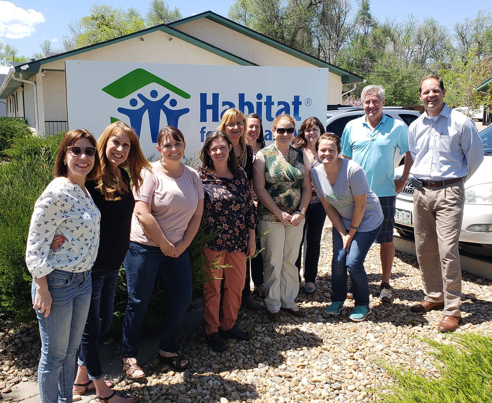 Featured above: Some of St. Vrain Habitat's staff and board members were joined by staff from the Habitat for Humanity Paraguay affiliate for a learning lunch in May 2018.