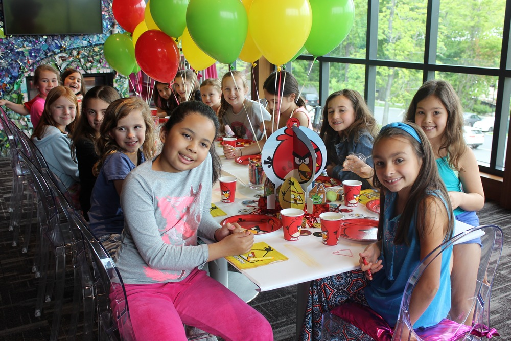 A group of young girls attend a birthday party themed to Angry Birds.