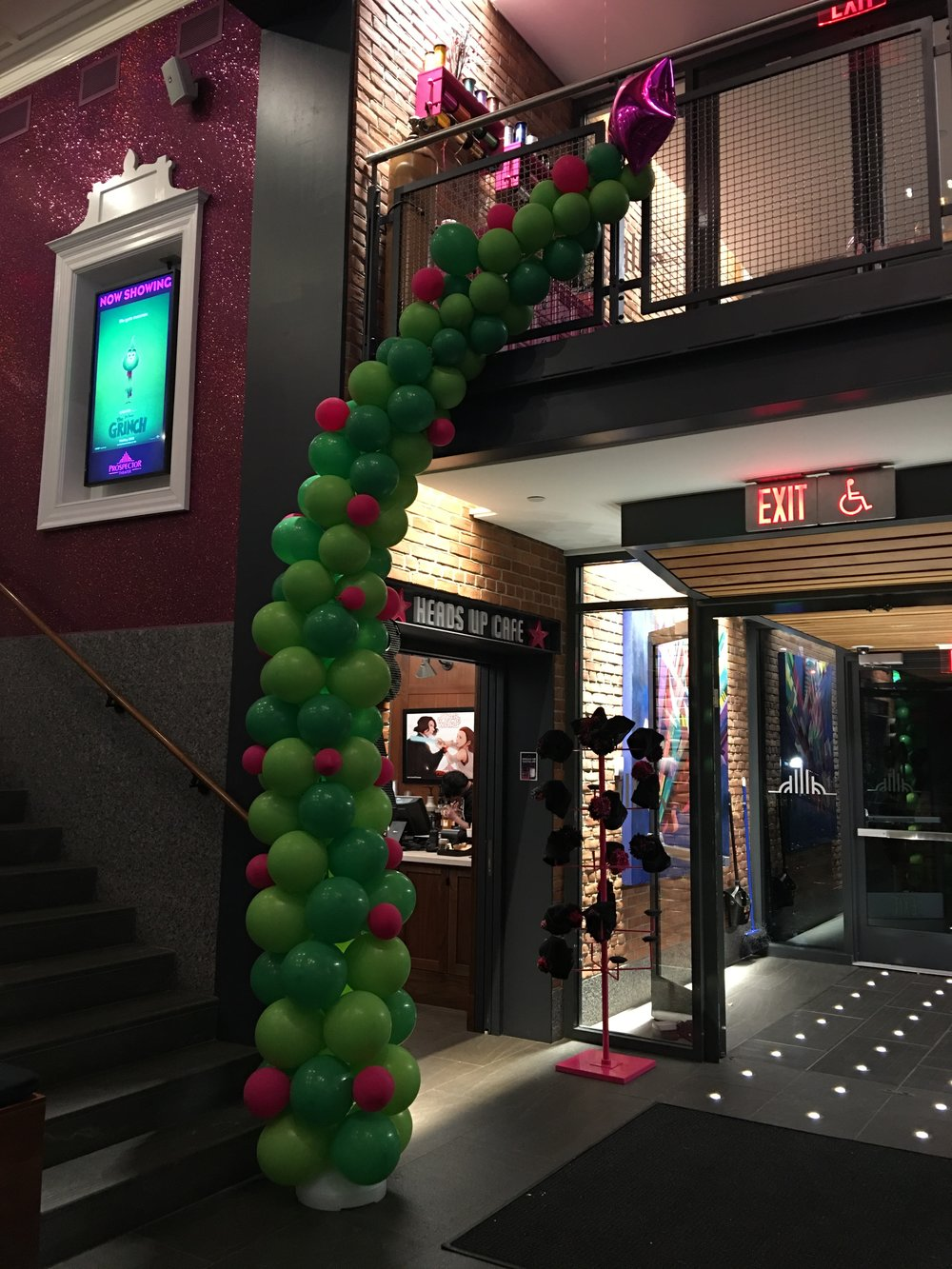"""Tracy D, Emma, Tracy M, Kathy, and Rebecca worked together to build and decorate the lobby with this """"Grinchy"""" tree."""