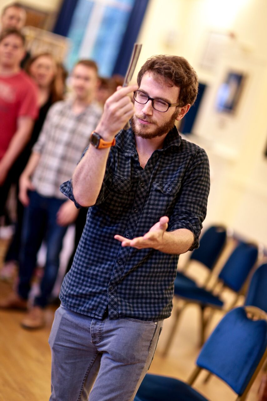 Neil in rehearsal with the cast (Photo courtesy of FRONT OF HOUSE PHOTOGRAPHY)