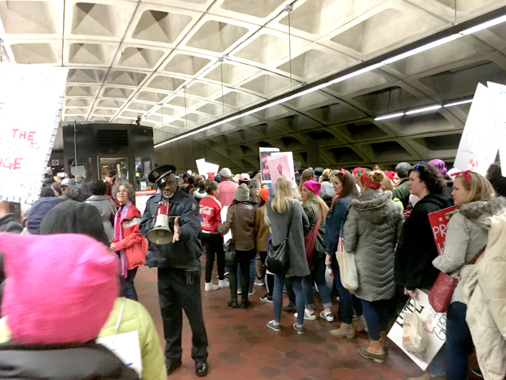 The really great WMATA station manager that directed the hoards to the exits, did little dances and kept everyone in good spirits by playing to the crowd.