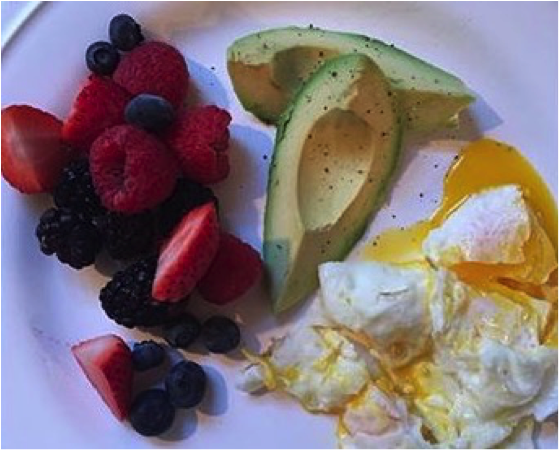 2 eggs over easy, ½ avocado and a handful of fruit