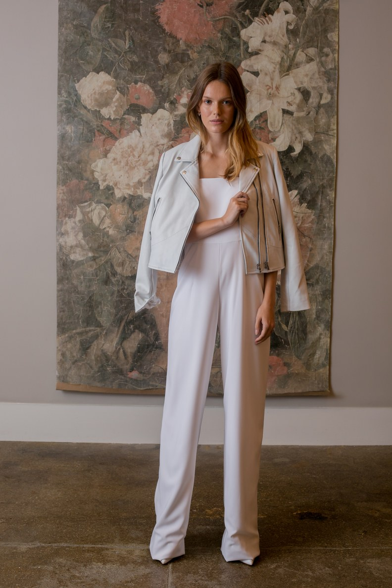 We can't forget the Rehearsal Dinner! Jumpsuits are in this season, and a rehearsal dinner is the perfect setting to style this look. This bridal jumpsuit is by BHLDN