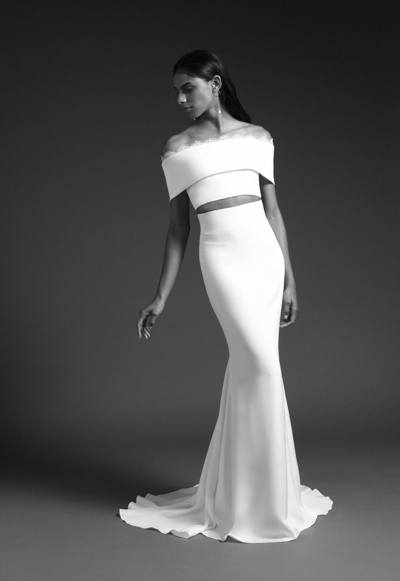 We are loving this twist on the popular off-the-shoulder look! Wedding dress by Cushnie.