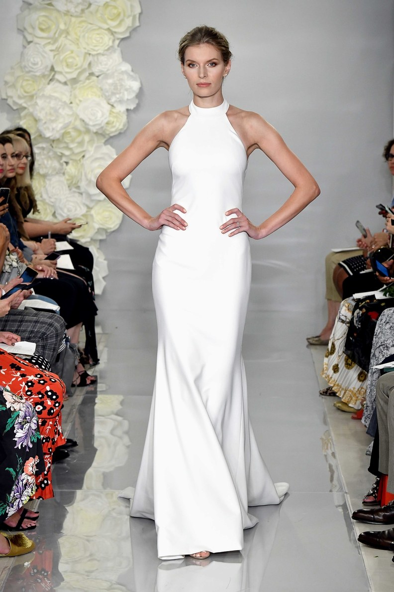 Another high neck dress. We love the bold shape this dress has! Courtesy of Theia.