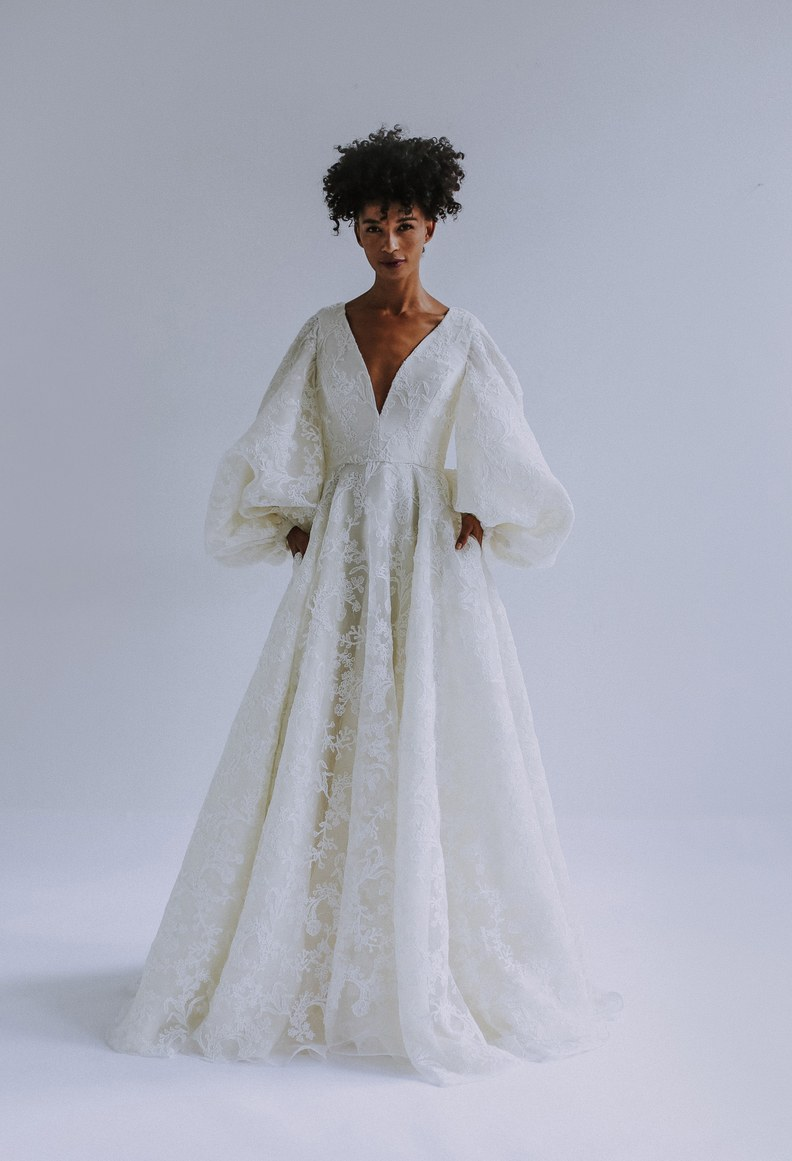 We don't think it gets much bolder than this! The sleeves, the lace, the neckline… wow! Wedding dress by Leanne Marshall.