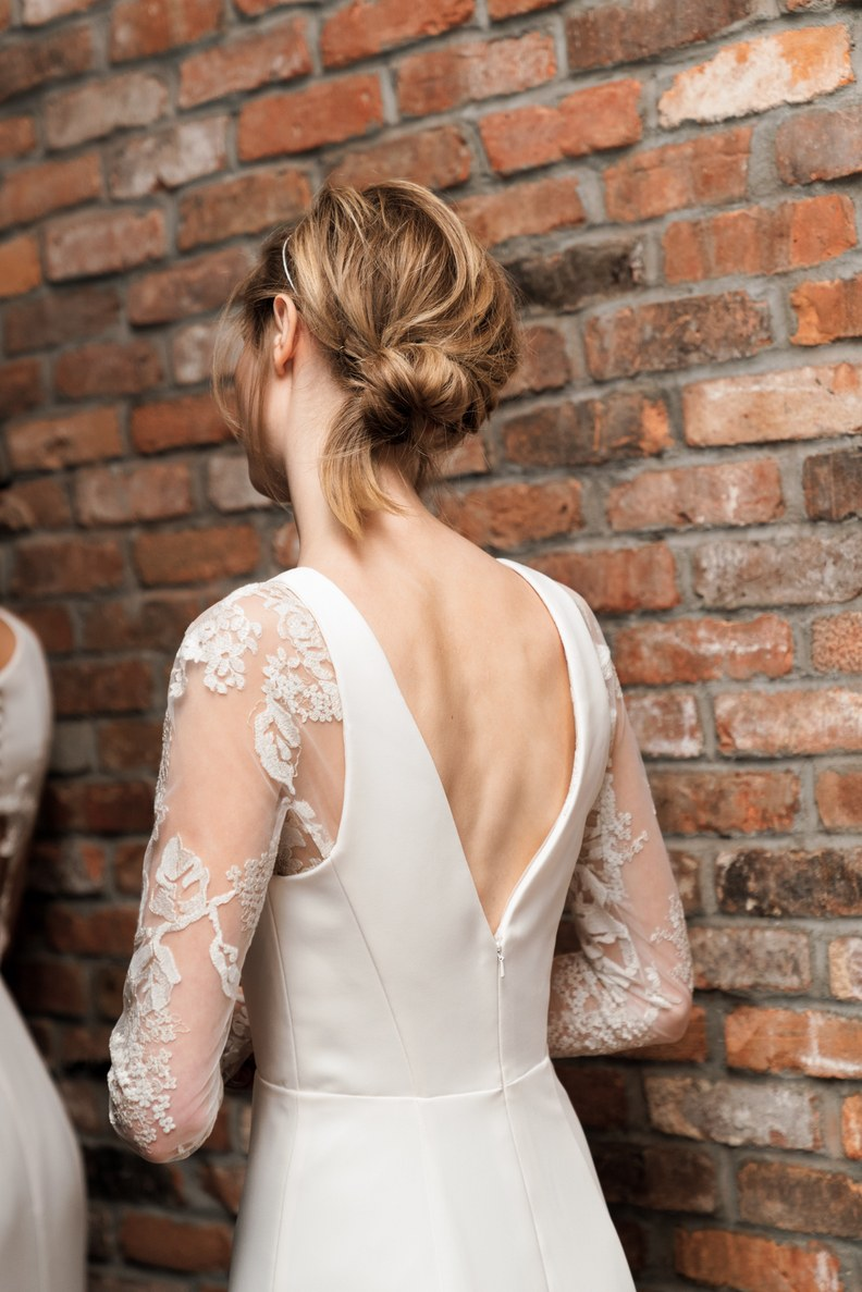 We love the classic look of this dress: the sleeves, lace and dainty V in the back. Photo by Heather Waraksa