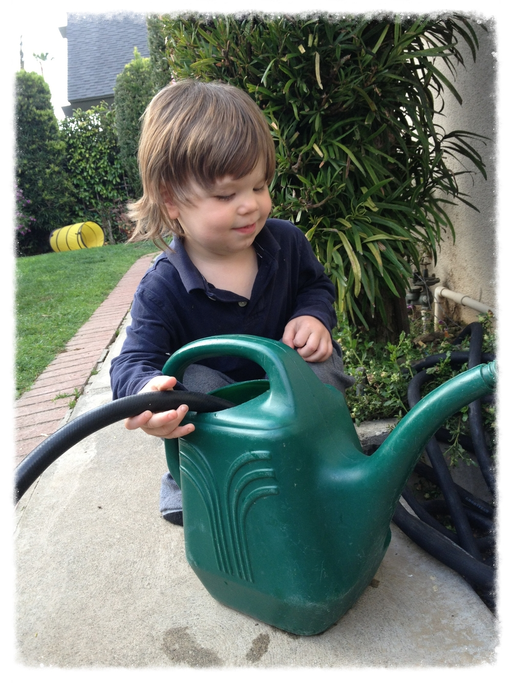 3 year old Darus partaking in one of his most favorite activities - watering!