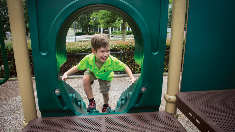 Six-year-old Bryce Goldblatt wasn't expected to walk. Now he's doing that and more. Photo by Lisa Helfert.
