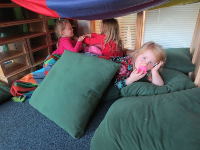 The children all nestled in at Stekkjarás. A collection of pillows and a fabric roof is all you need sometimes.