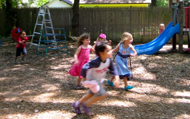 The children dash across the playground, June 2009