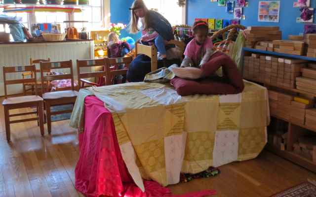 Her room was under the table. The space on top of the table had already been negotiated and claimed by another princess. Another room, built in the play tower using a beanbag chair, had also been claimed. Her only option was to convince someone to share.