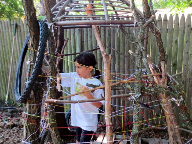 The older children begin the weaving. There were several groups of children weaving. This weaving held the branches together certainly, but also it created the secret door. The door is so secret that you will never find it. Ever.