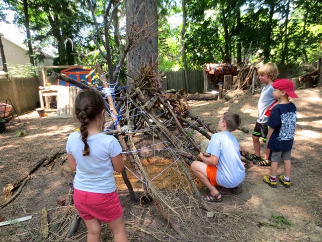 The fort takes shape. Different groups of children would drag branches over. The builder would quietly move the branches as needed and in this way, the younger children felt part of the construction, but the builder made sure the structure was sound.