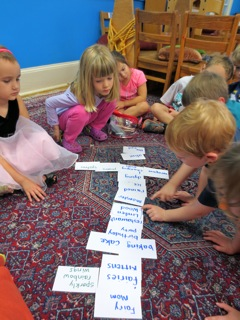 "Using story cards to map out a dramatic play arc. The children have named this arc ""Linden Wood."" They are able and are encouraged to add details to the story line. During this iteration, they added a ""sparkly rainbow wings"" card next to the ""fairies"" card. They also asked to remove the cards, ""alive again"" and ""the end"" because including them means that the story would be over."