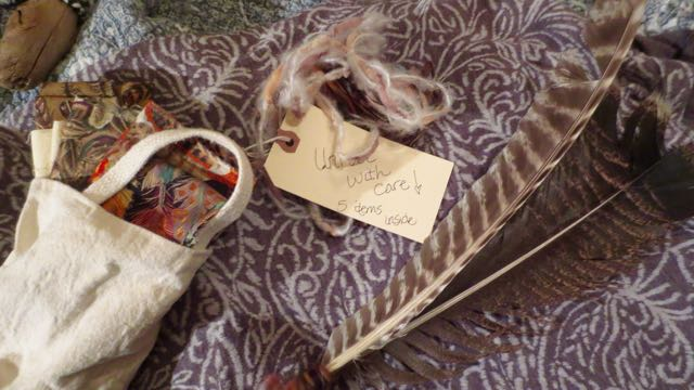 "The feathers and a collection of feather fabrics. The package also included the book, ""The Perfect Purple Feather."" The book was an instant hit with the children."