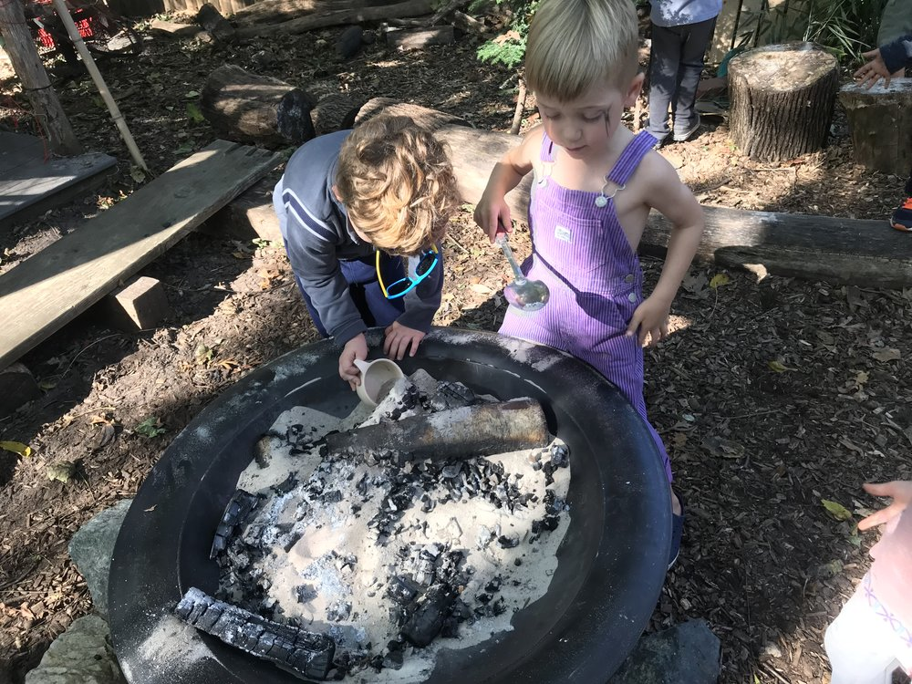 The day after a membership meeting, the children always look for evidence of their parents' work and learning. When Lesley, their teacher told them what the parents created the night before, they instantly sifted through the fire pit looking for wishes. They lifted these out in teacups and spoons, running through the play yard to share these far and wide.