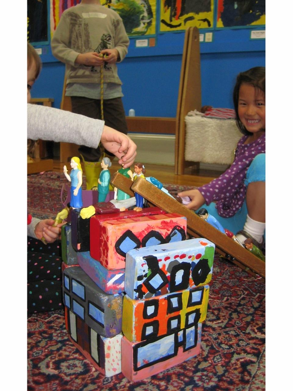 Painted blocks and play people.jpg