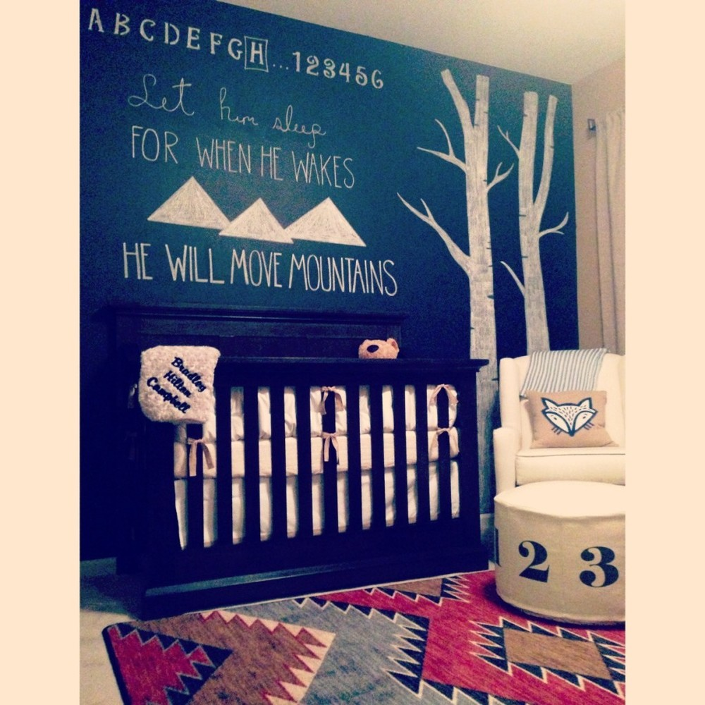 A chalk wall makes it easy to change the theme as they grow up! Check out this one in an adorable fox-themed nursery on  Project Nursery .