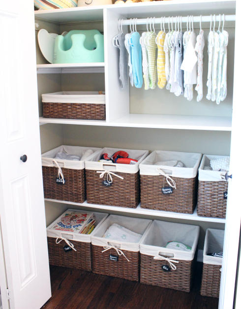 Making it easy to keep things organized before the baby comes is key! The simpler it is to stay organized, the less you'll end up doing after. Like adding labeled bins in the closet, so everything has a place. Check out this closet by  Amanda at 12 Oaks.