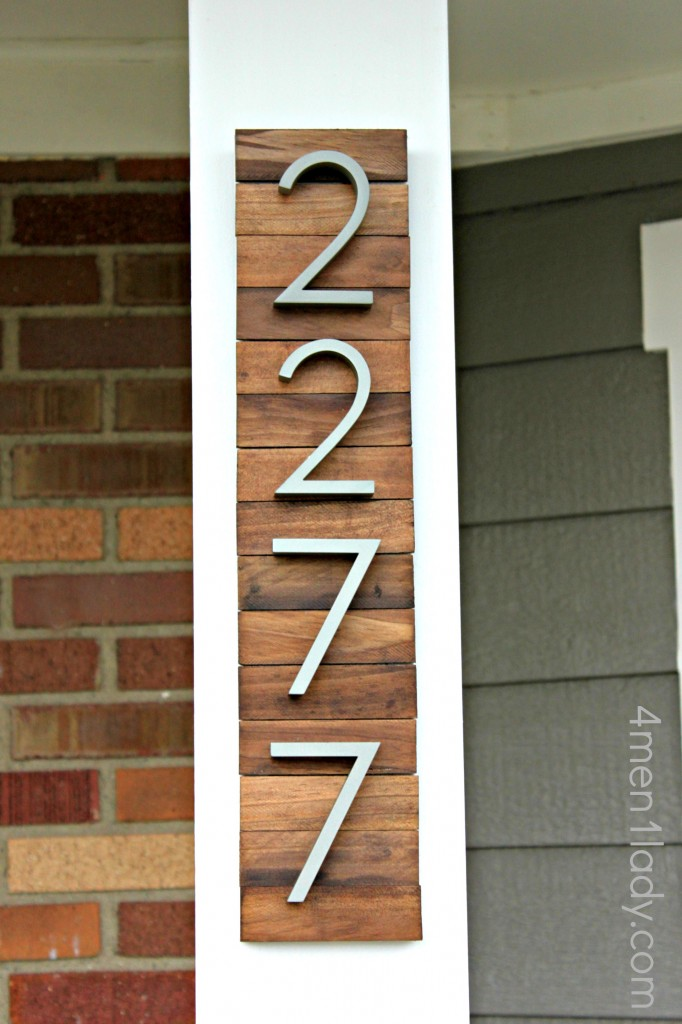This awesome installation for modern style house numbers is created with paint sticks and stain. So easy and so stylish! Check out the tutorial on  4 Men 1 Lady.