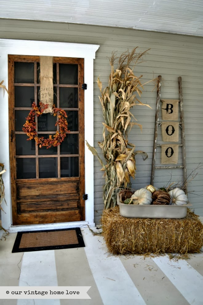 Having a solid base allows for fun seasonal decoration, too! Include your favorite things for each season: corn stalks and pumpkins for fall; a small tree and lights for winter, fresh flowers and bright colors for spring, lemons or red, white and blue for summer. This awesome fall-scape is from  Our Vintage Home Love.