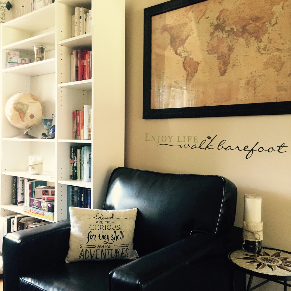 My livingroom layout change this weekend created a cozy travel-themed reading corner.