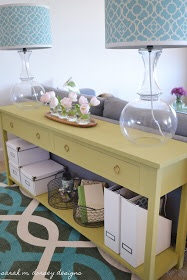Awesome color and storage options abound with this sofa table by  Sarah M Dorsey Designs.