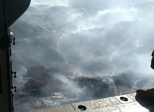 An aerial shot of the wildfires in Sevier county taken from a Tennessee National Guard helicopter on Nov. 29, 2016. The fires burned hundreds of acres and destroyed several buildings in Gatlinburg. (Photo by Staff Sgt. William Jones)