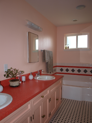New master bath, circa 2010...with vanity, sinks, medicine cabinets, and tub circa 1948.