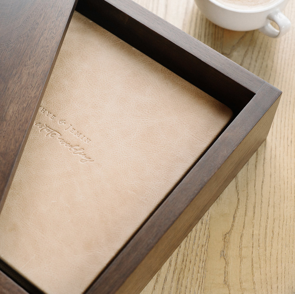 Custom Embossing & Wooden Keepsake Box - Each album is customized with your photos, embossed with your name and wedding date, and presented in a beautiful wooden keepsake box.