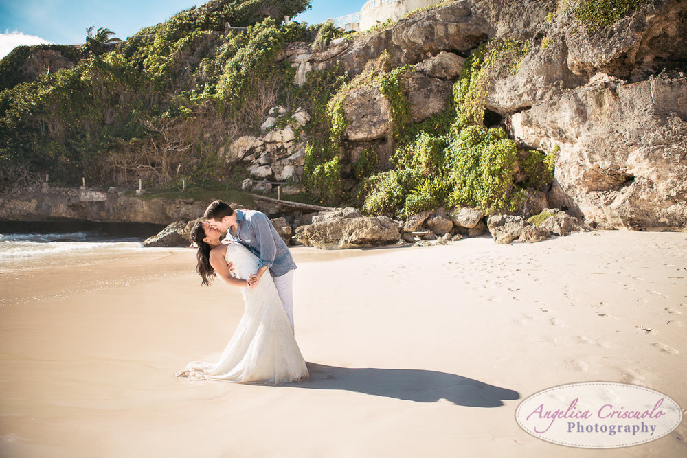 Destination Wedding photo kiss on beach dip the bride KristyPhilBarbadosWEB-1145