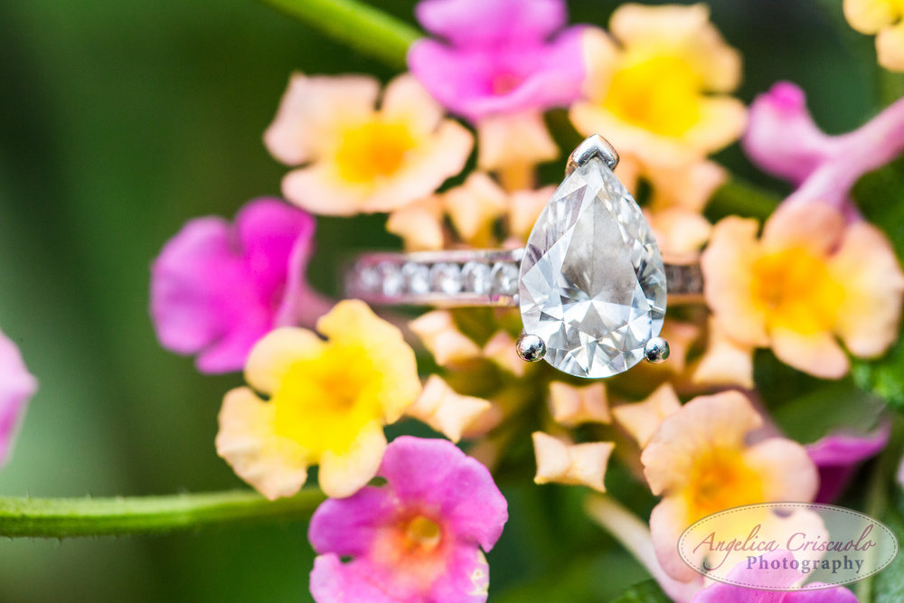 Pear shape wedding engagement ring with chanel