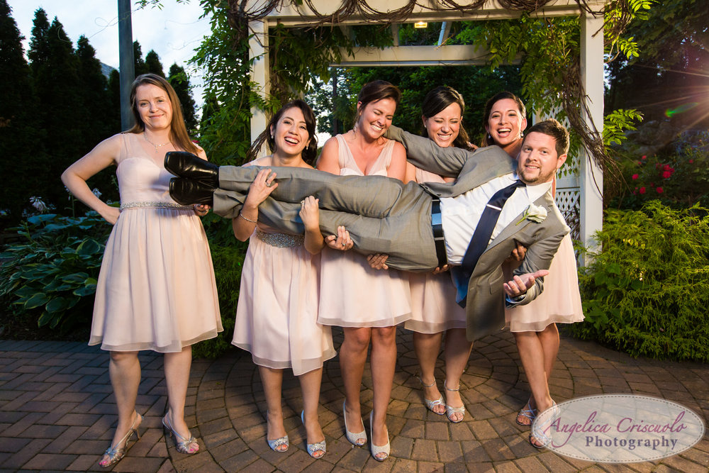 Bride and groom wedding photo ideas New York Groom carried by bridesmaids