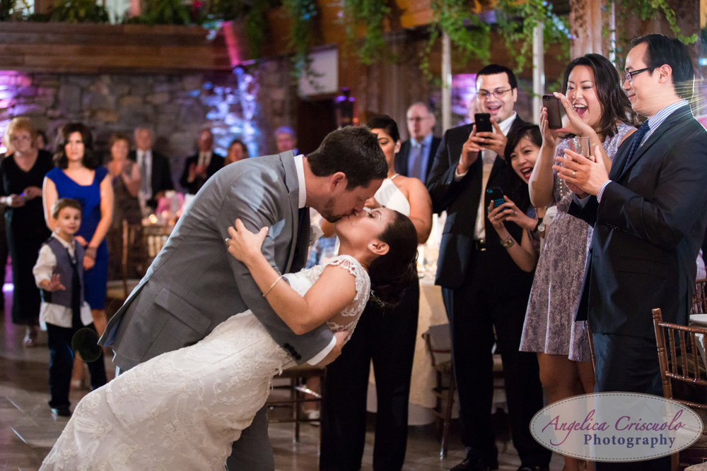 Fox Hollow Caters New York Westbury Bride and Groom photo ideas dip and kiss