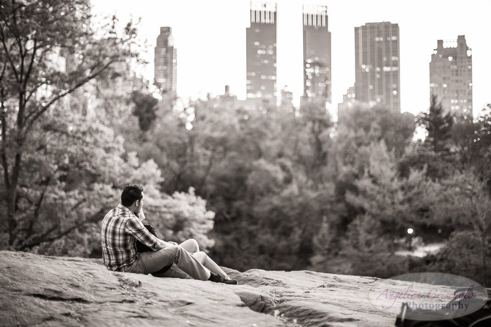 New York Engagement Photography Central Park skyline rock