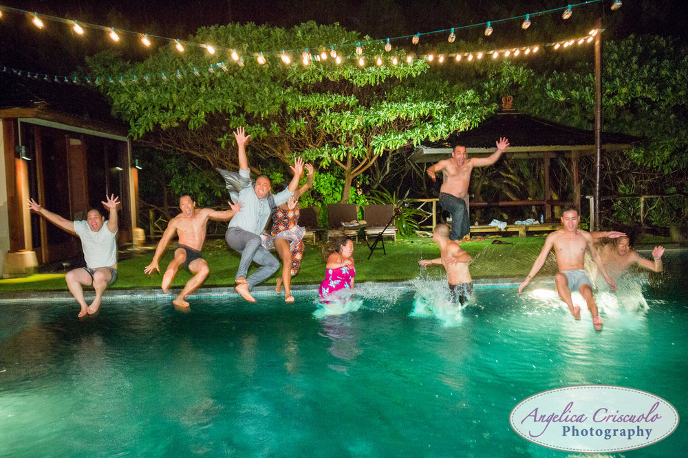 Oahu Hawaii Destination Wedding Photos guests jumping in the pool