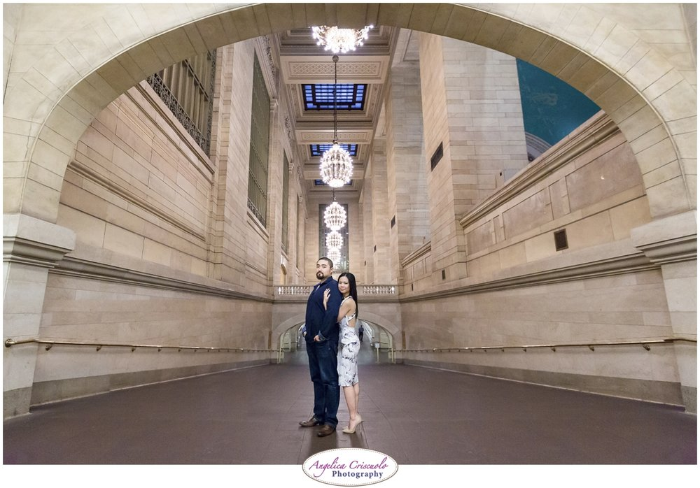 Grand Central Engagement Photographer photo ideas posing in tunnel near whispering