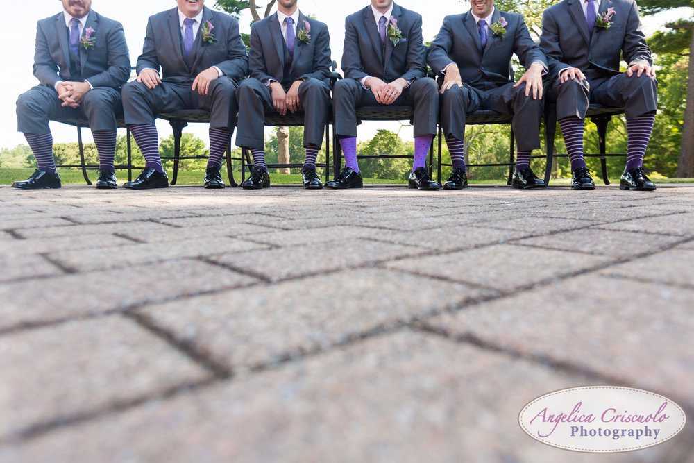 Groomsmen photos with purple socks.